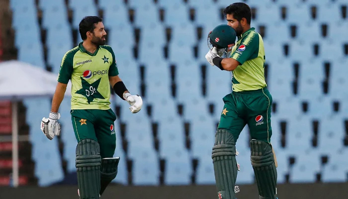 Pakistan´s captain Babar Azam (R) celebrates after scoring a century (100 runs) as Pakistan´s Mohammad Rizwan (L) looks on during the third Twenty20 international cricket match between South Africa and Pakistan at SuperSport Park in Centurion on April 14, 2021. — AFP/File