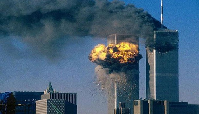 In this Sept. 11, 2001, file photo, smoke and flames are erupting from the twin towers of New York Citys after hijacked planes crashed into the towers.