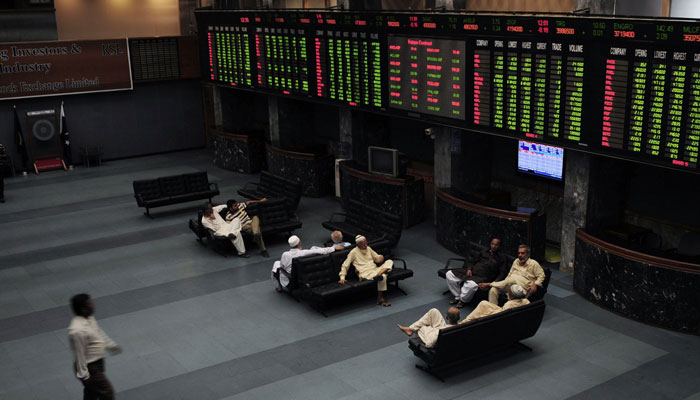 Investors can be seen sitting in the hall at The Pakistan Stock Exchange. — AFP/File