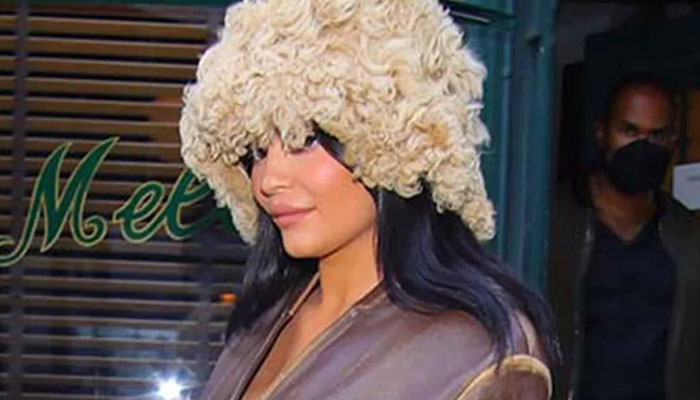 Kylie Jenner, in a perfectly fashionable ensemble, walks out of her house for lunch with her daughter