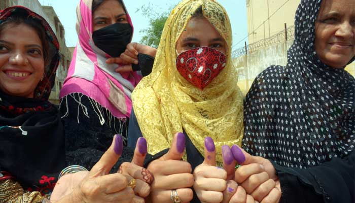 A group of women show off their inked thumbs after they cast their ballot at a polling station in Karachi, for cantonment board elections, on September 12, 2021. — The News/Zahid Rahman