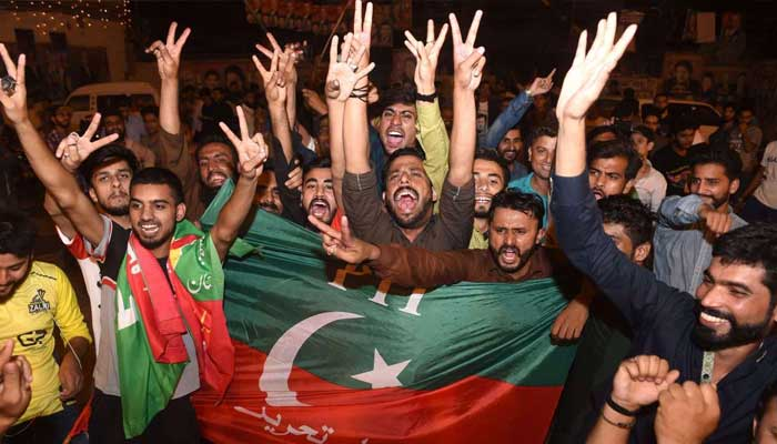 PTI supporters out celebrating on the streets in jubilation after the party won the elections in 2018. — AFP