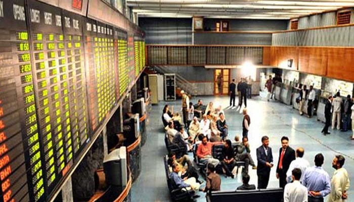 Traders pictured during business hours in the premises of the Pakistan Stock Exchange. — AFP/File