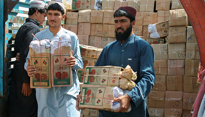 Labourers unload boxes of pomegranates from Afghanistan, from a truck at the Friendship Gate crossing point, in the Pakistan-Afghanistan border town of Chaman, Pakistan, September 7, 2021. — Reuters/File