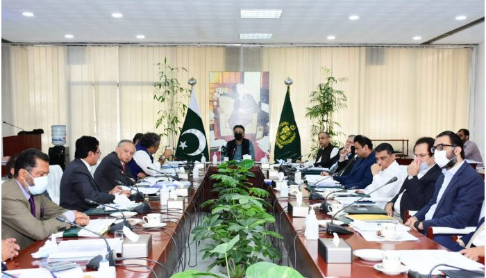 Federal Minister for Planning, Development and Special Initiatives Asad Umar chairing the meeting ofCabinet Committee on Energy. — APP