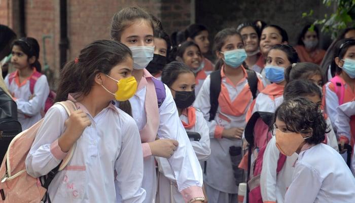 Students waiting for their school van in Lahore, on September 4, 2021. — Online/File