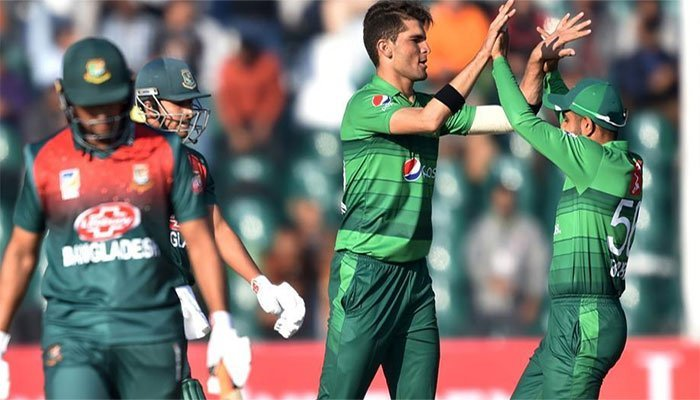 Shaheen Afridi and Babar Azam celebrate after taking a wicket. Photo: AFP