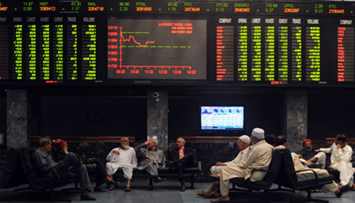 Investors are sitting in the hall of Pakistan Stock Exchange in Karachi. — AFP