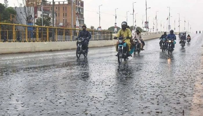 Motorcyclists can be seen on the roads of Karachi as the city received light rain on Wednesday. — Geo News/File