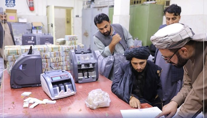 Men are pictured as Afghanistans Taliban-controlled central bank seizes a large amount of money in cash and gold from former top government officials, including former vice president Amrullah Saleh, in Afghanistan, in this handout obtained by Reuters on September 15, 2021. — Reuters