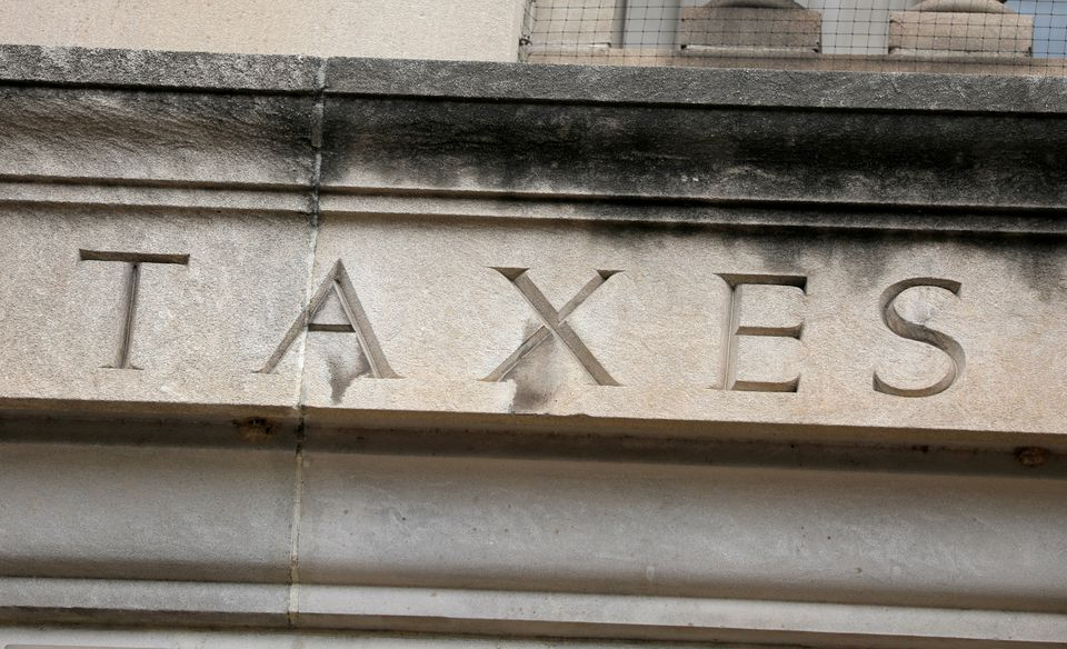 The word taxes is seen engraved at the headquarters of the Internal Revenue Service (IRS) in Washington, D.C., US, on May 10, 2021. REUTERS/Andrew Kelly