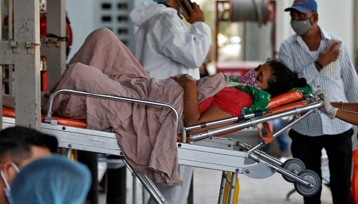 A patient is wheeled inside a COVID-19 hospital for treatment, amidst the spread of the coronavirus disease (COVID-19) in Ahmedabad, India, April 19, 2021. — Reuters/File
