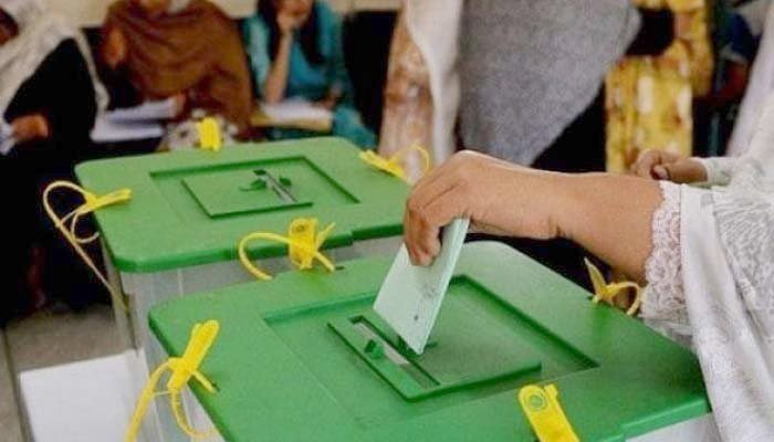 A woman can be seen casting her vote. — File photo