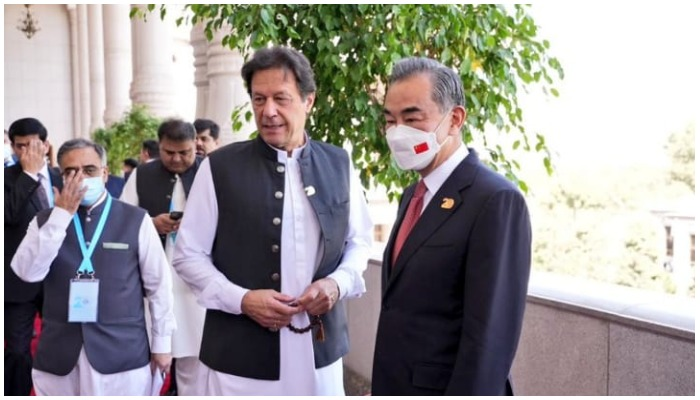 Chinese Foreign Minister Wang Yi (right) calls on Prime Minister Imran Khan in Dushanbe on the sidelines of the Shanghai Cooperation Organisation Council of Heads of State, on September 17, 2021. — @PakPMO/Twitter