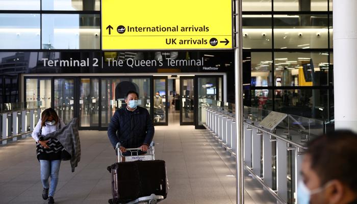Travellers walk through Terminal 2 at Heathrow Airport, amid the coronavirus disease (COVID-19) outbreak in London, Britain February 14, 2021. — Reuters/File