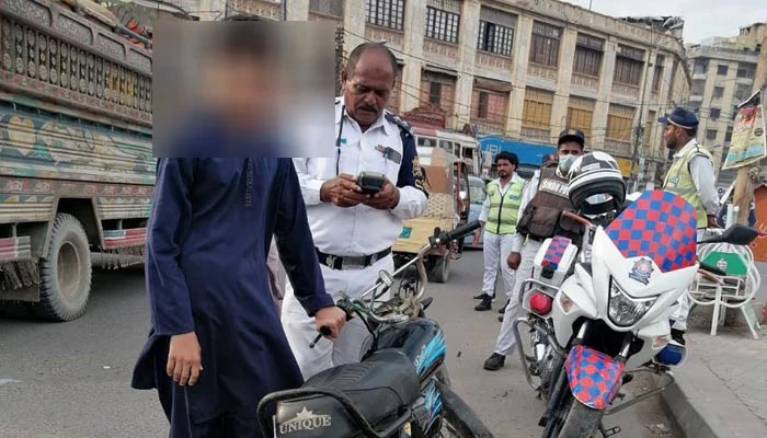 Traffic police imposing fines on people for breaking traffic rules. — Karachi Traffic Police