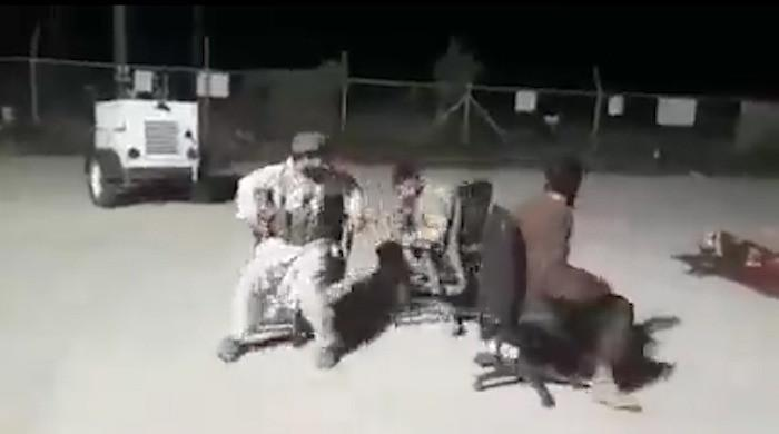 Watch: Taliban fighters play dodgem cars on office chairs