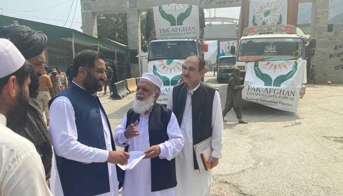 Pak-Afghan Cooperation Forum trucks can be seen parked in the backdrop in this photo shared by Ambassador to Afghanistan Mansoor Ahmad Khan, on September 19, 2021. — Twitter/Mansoor Ahmad Khan