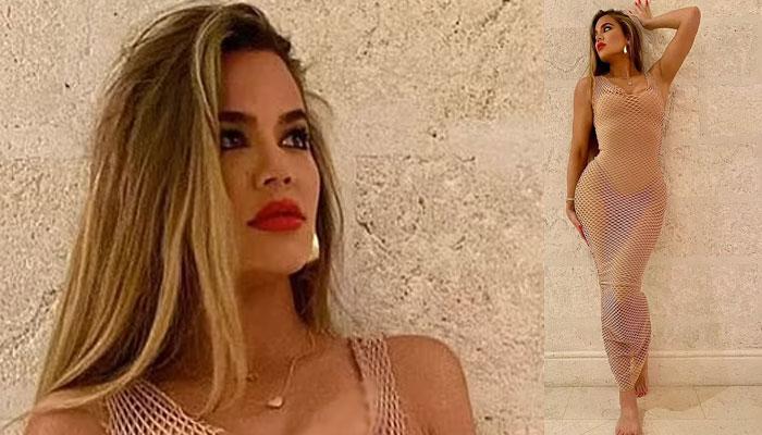 Khloe Kardashian turns the heat up as she rocks see-through net dress