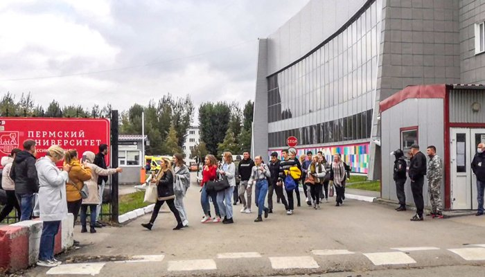 Students evacuate a building of the Perm university campus in Perm on September 20, 2021 following a shooting. — AFP