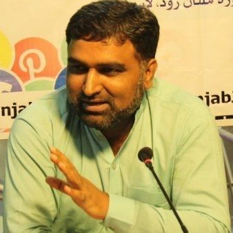 Shamsuddin speaks to JI workers.
