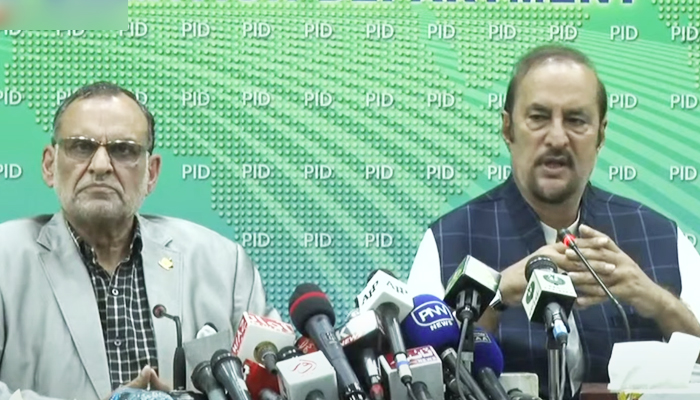 Advisor to the Prime Minister on Parliamentary Affairs Dr Babar Awan (right) addressing a press conference alongsideFederal Minister for Railways Azam Khan Swati in Islamabad, on September 20, 2021. — YouTube/HumNewsLive