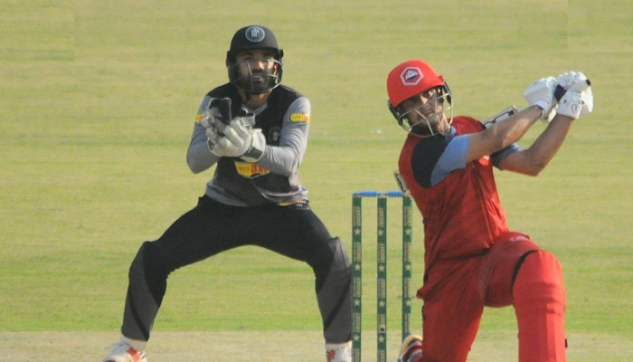 Haider Ali smashes a ball for six while the wicketkeeper looks on. — File photo