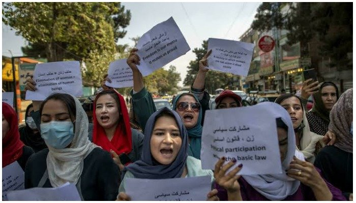About a dozen Afghan women protested briefly Sunday outside the old Ministry for Womens Affairs, which has now been replaced by a department that earned notoriety for enforcing strict islamic doctrine.— AFP