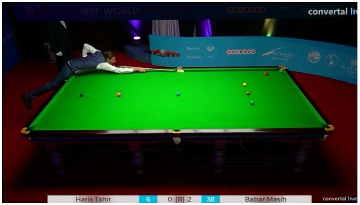Pakistani snooker player Babar Masih trying to pocket a ball at a match of IBSF 6 Reds World Cup.