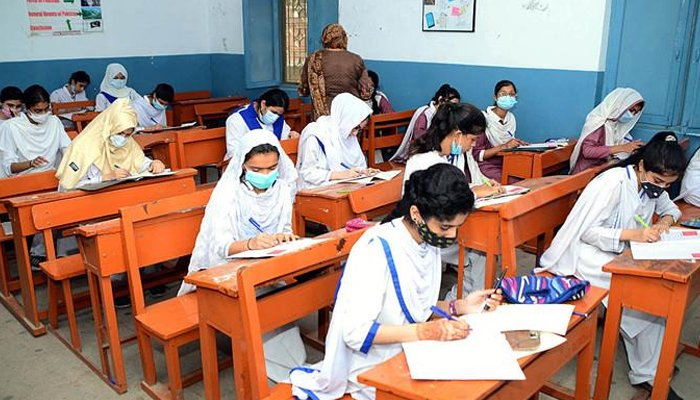 Students solving question papers during their annual examination in Hyderabad, on July 27, 2021. — APP/File