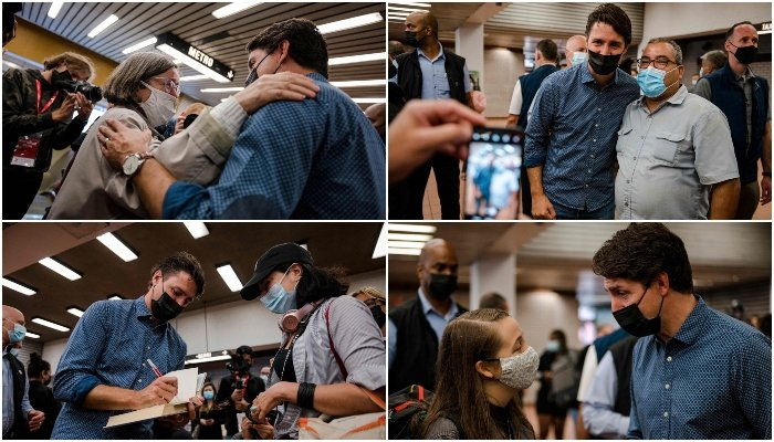 Canadian Prime Minister Justin Trudeau is seen during a meet and greet with constituents at the Jarry Metro station in Montreal, Quebec early on the morning of September 21, 2021. — AFP