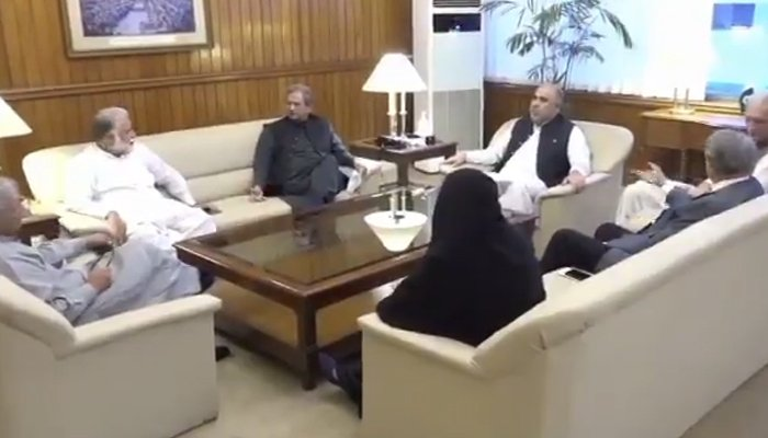 National Assembly Speaker Asad Qaiser (sitting on the centre chair) holds withOpposition and government lawmakers in Islamabad, on September 21, 2021. — Twitter/