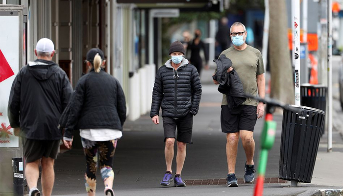 People wear masks while stepping outside during a lockdown to curb the spread of a coronavirus disease outbreak, in Auckland. — Reuters/File
