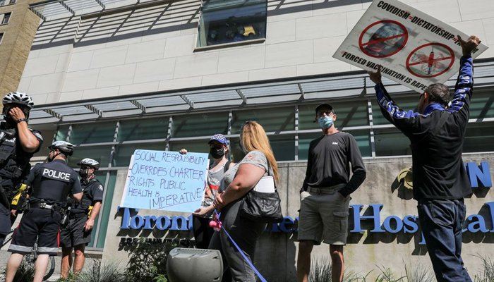 Protesters hold signs during an anti-vaccine mandate protest outside Toronto General Hospital in Toronto, Ontario, Canada September 13, 2021. — Reuters/File