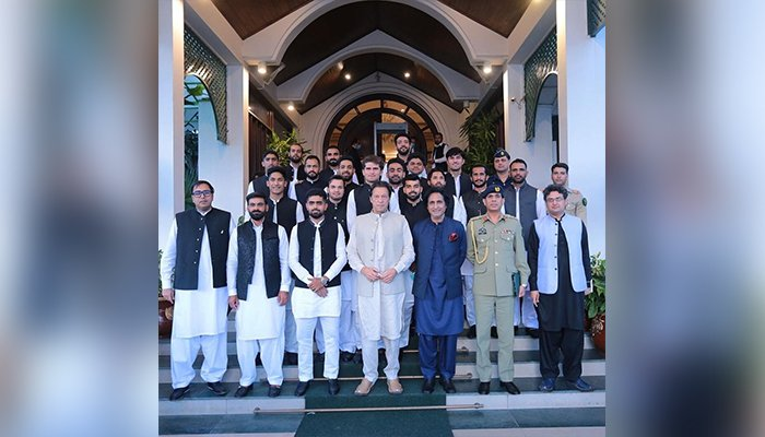 Pakistani T20 World Cup Squad takes a group photo with Prime Minister Imran Khan (centre) after a meeting at PM House, in Islamabad, on September 22, 2021. — Instagram