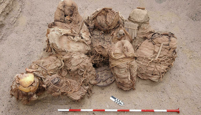 A handout picture released by Peruvian gas company Calidda shows objects, food, artefacts, and ancient funeral bundles containing the remains of eight people. AFP