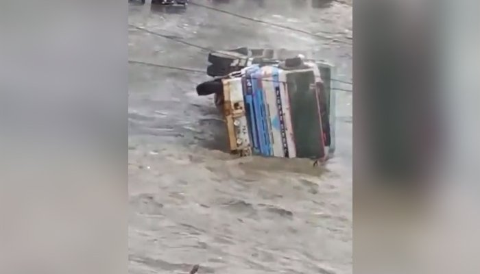 A truck upturns in Karachis Nagan area as rains lashed the port city, on September 23, 2021. — Twitter/NKMalazai