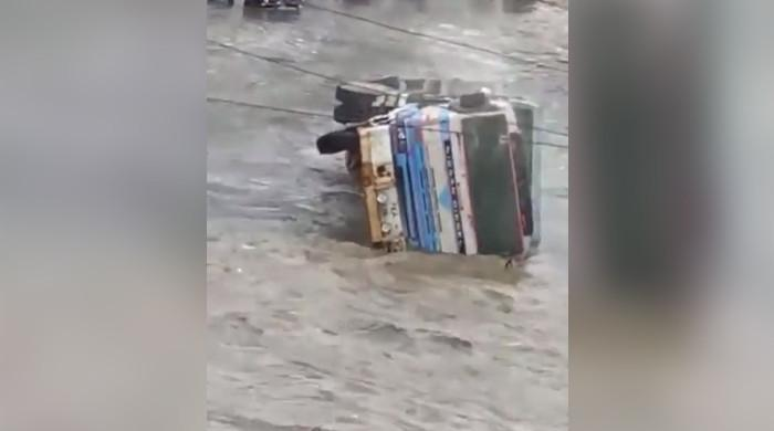 WATCH: Truck upturns as rain lashes Karachi