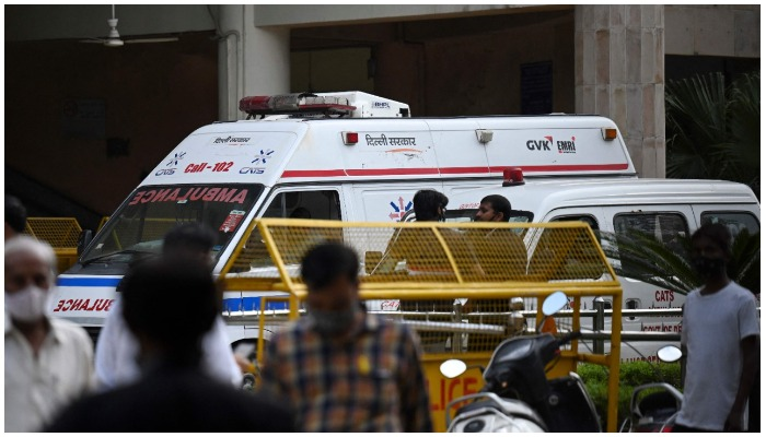An ambulance is seen inside the Rohini court in New Delhi on September 24, 2021, after a notorious Indian gangster was killed by gunmen dressed as lawyers in a bloody shootout in a courtroom where three people died, local media reported. (Photo by Money SHARMA / AFP)