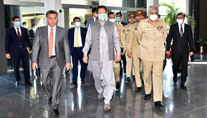 Prime Minister Imran Khan (C) and Chief of Army Staff General Qamar Javed Bajwa received by Director General Inter Services Intelligence Lieutenant General Faiz Hamid, at the ISI Secretariat, on September 24, 2021. — Photo courtesy Prime Ministers Office