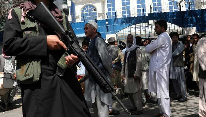 A Taliban security member holding a rifle ensures order in front of Azizi Bank in Kabul, Afghanistan, September 4, 2021. — WANA (West Asia News Agency) via Reuters
