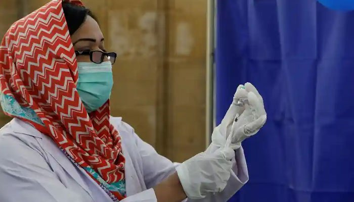 A nurse preparing to administer a COVID-19 shot in Pakistan. Photo: AFP