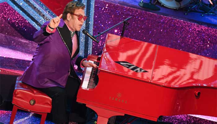 Elton John performs 'Tiny Dancer' as he kicks off world-spanning gigs for climate, vaccines
