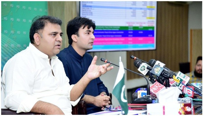 Federal ministers Fawad Chaudhry and Murad Saeed addressing a press conference in Islamabad— PID