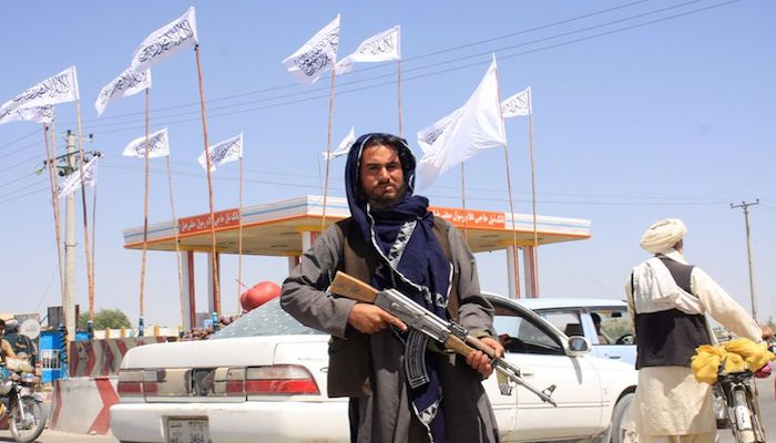A Taliban fighter looks on as he stands at the city of Ghazni, Afghanistan August 14, 2021. Photo: Reuters