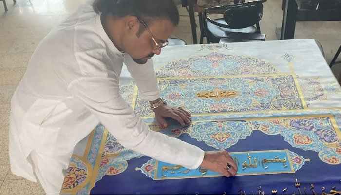 Shahid Rassam working on the world largest Holy Quran. Photo: file