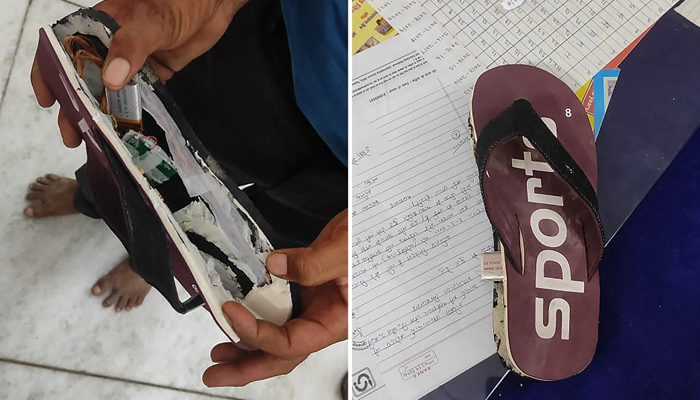 This combination created of photos taken on September 26, 2021, a man shows a flip-flop with concealed bluetooth device (L) and a flip-flop with concealed bluetooth device in Ajmer. — AFP