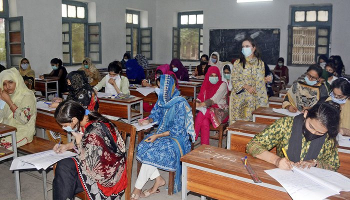 Students are busy solving their question papers during the matriculations annual examination at Government Post Graduate Islamia College in Lahore, on July 30. — Online/File