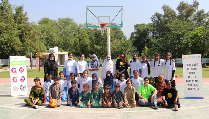 A group picture of children at a three-day basketball training camp. —Photo by author