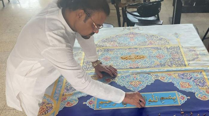 Pakistani artist making world's largest Holy Quran with 200kg gold-plated words